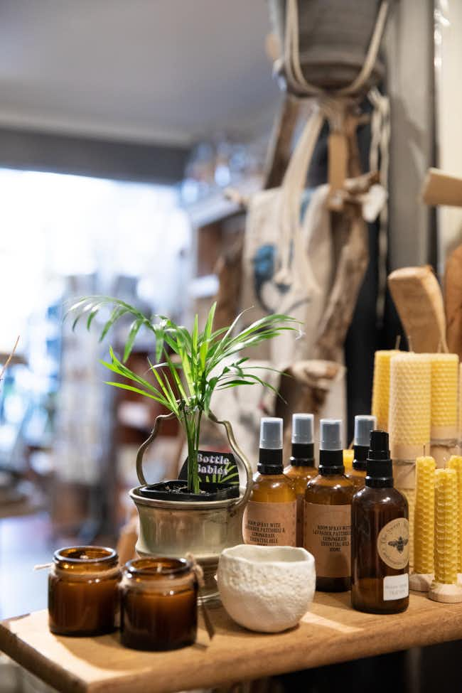Bees wax candles and assortment of sprays at Tribe in Castlemaine